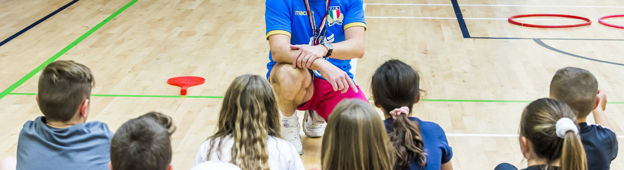 sport coach teaching children