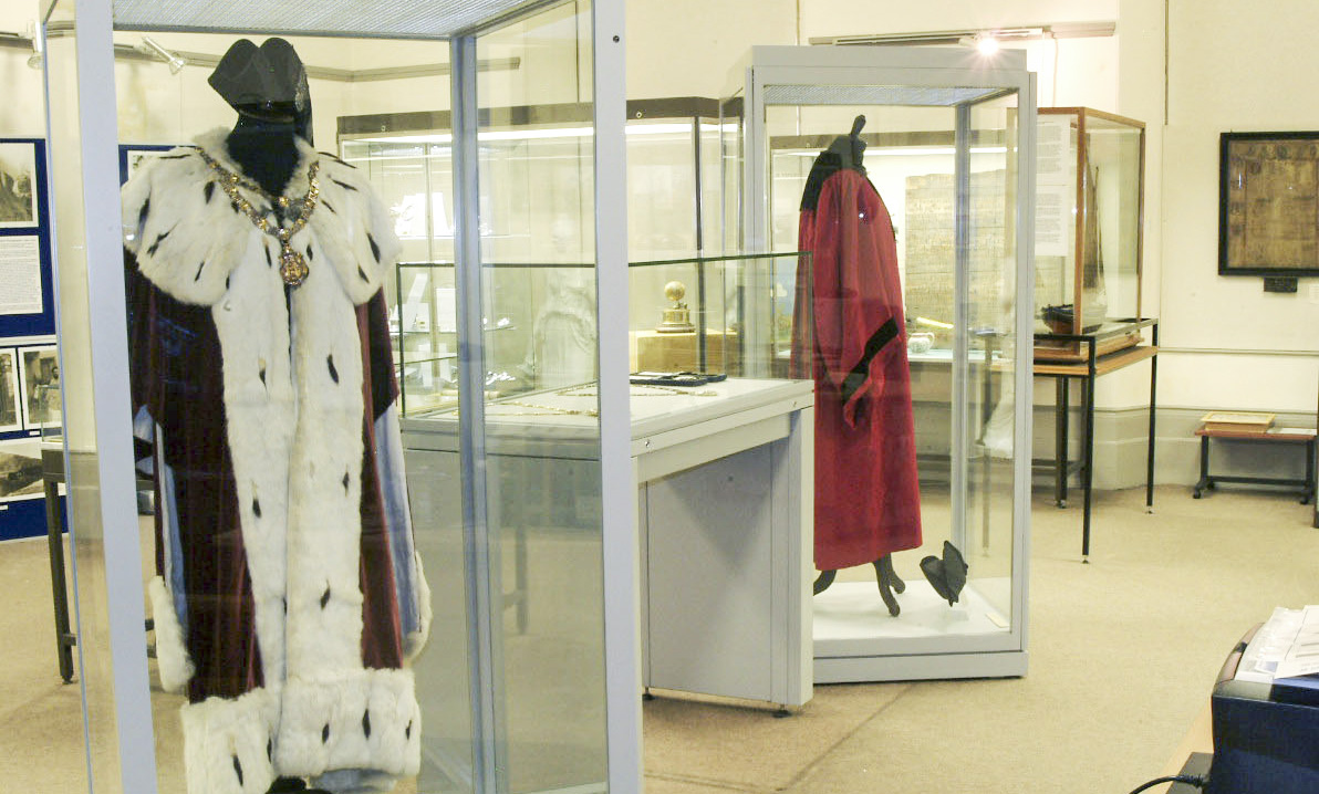 inside view of Banff Museum showing some costumes in cases