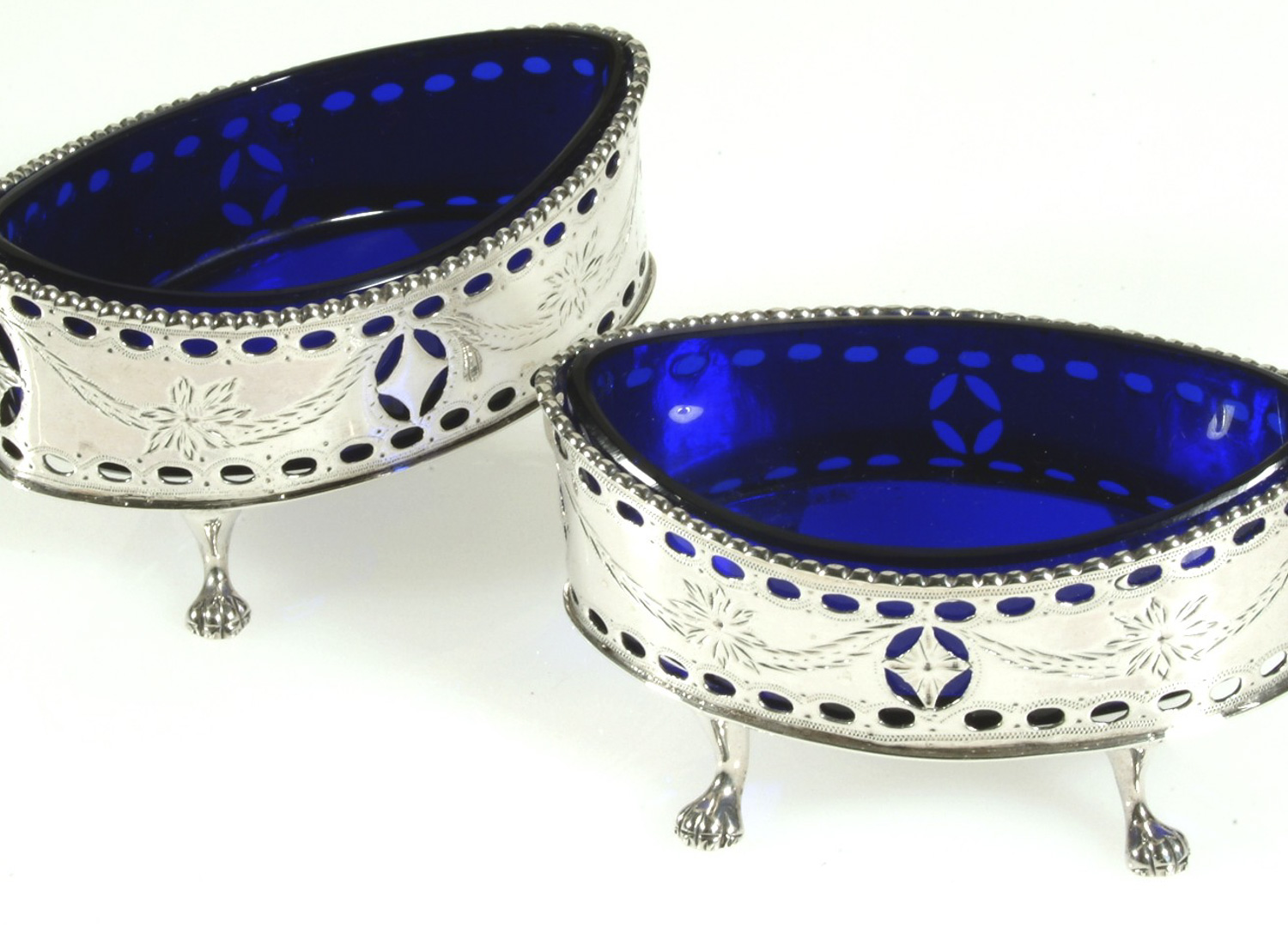 silver salt containers with blue glass.