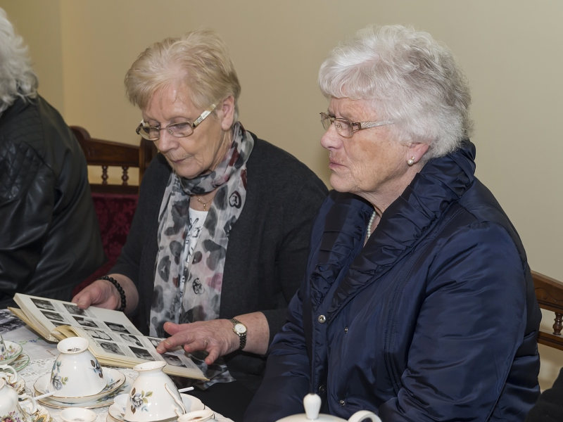 older ladies chatting over tea
