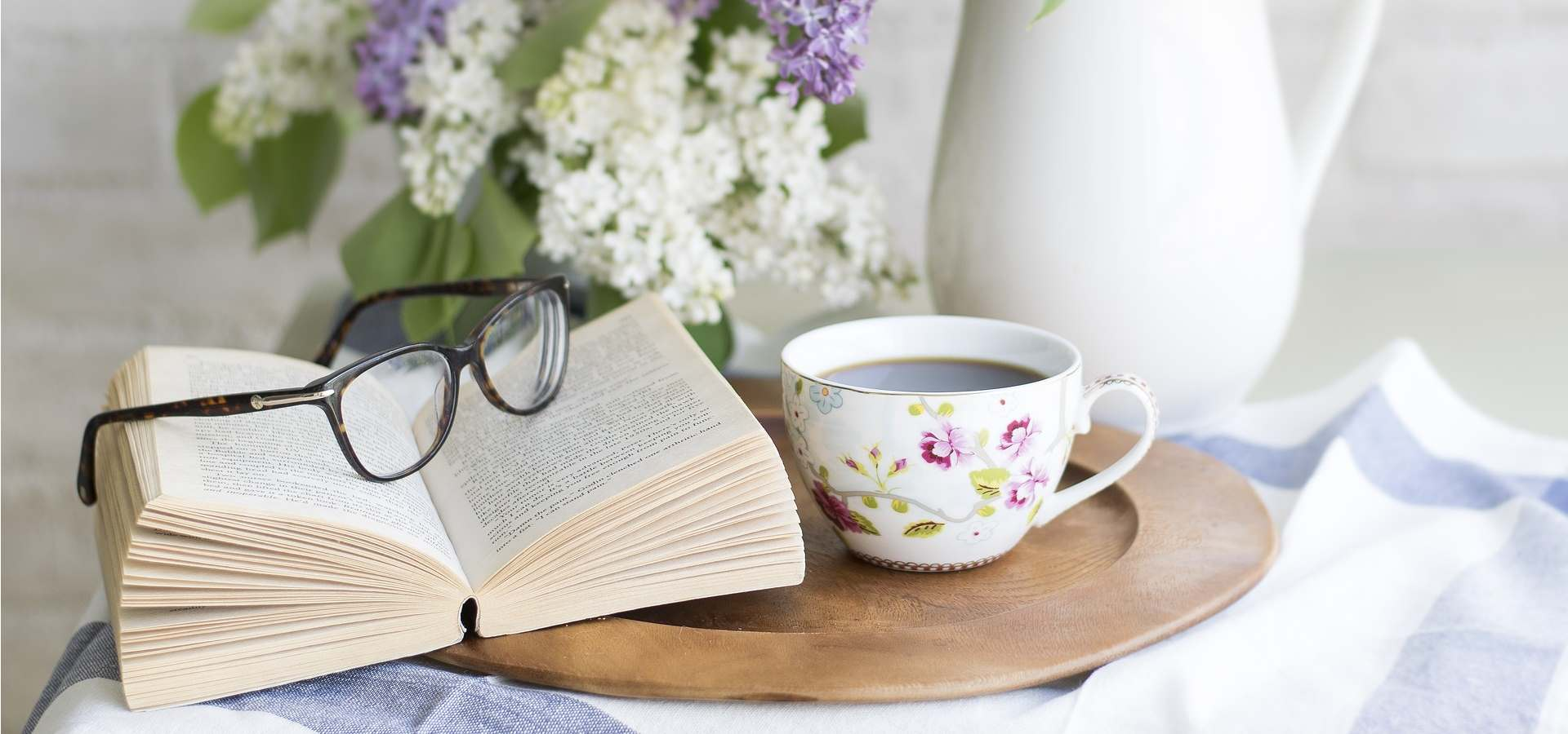 glasses sitting on top of a book