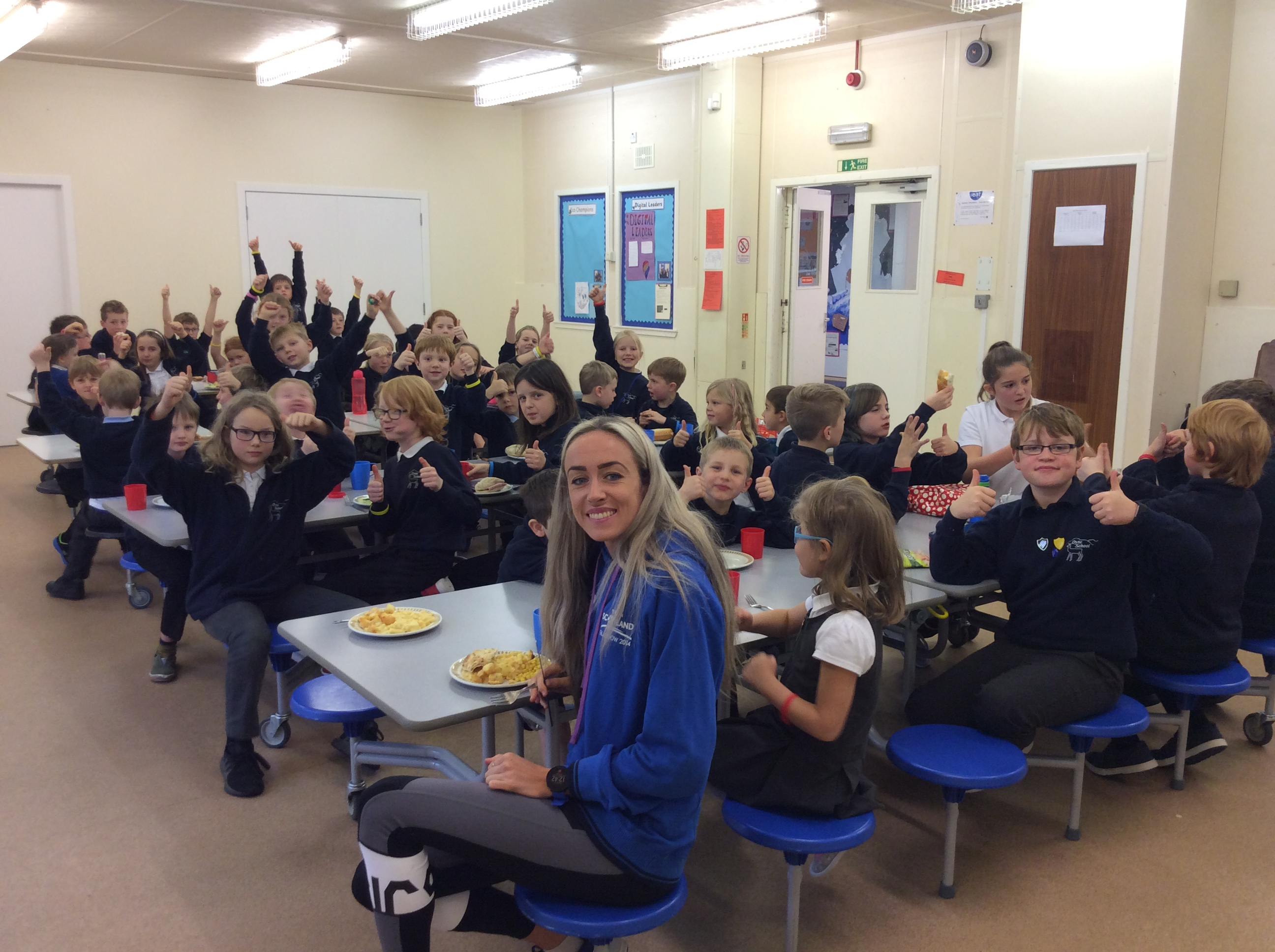 Athlete Eilish McColgan with primary school pupils