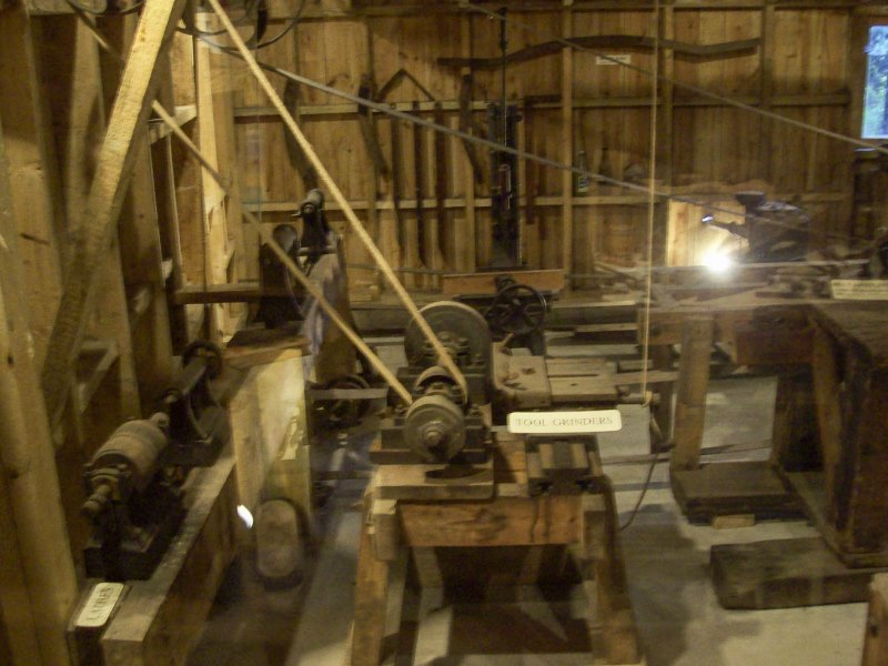 Interior view of workshop with large belt driven tools.