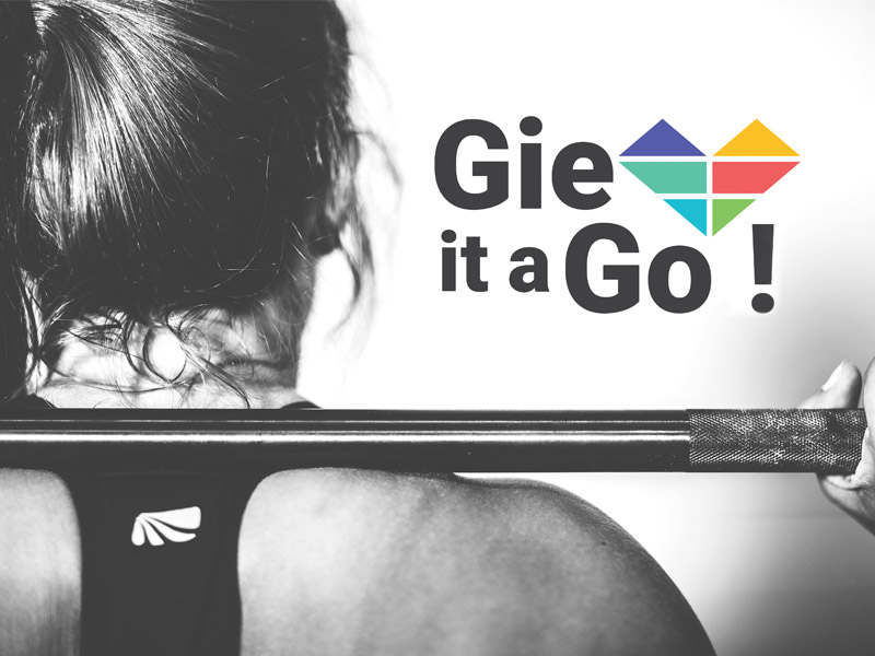 Close up of female weight lifting. Gie it a Go logo