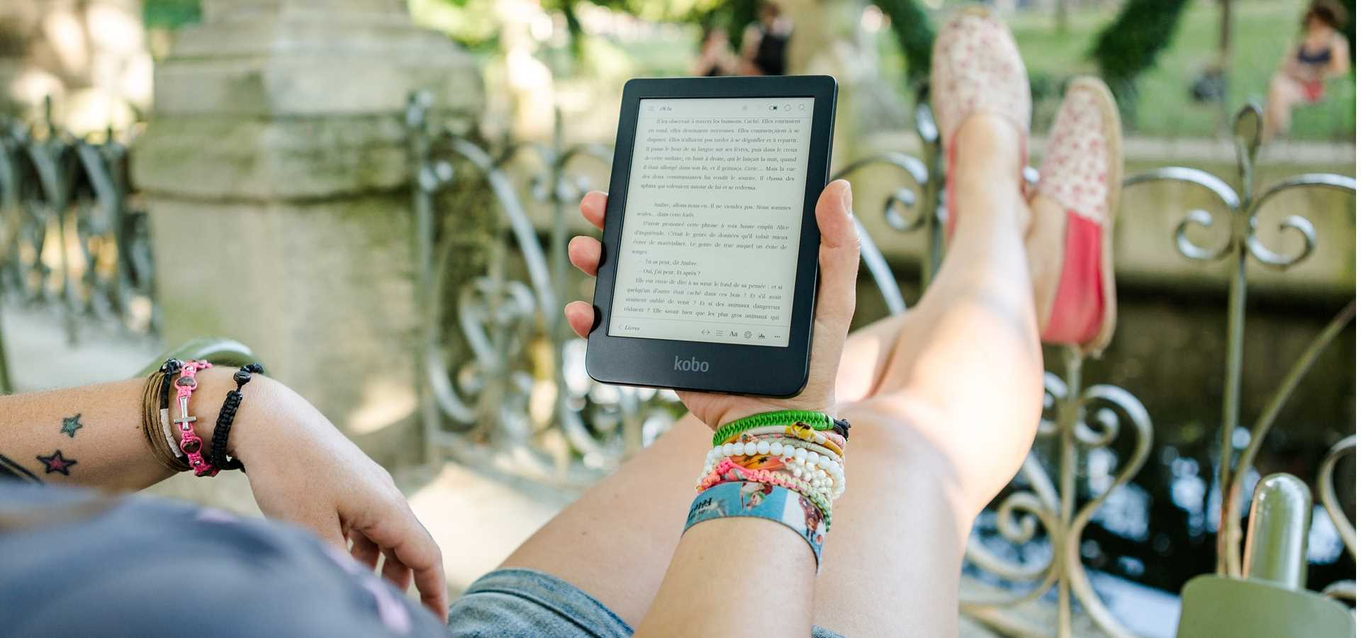 person relaxing outdoors with an e Reader