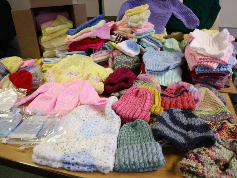 Lots of knitted items donated as part of the cosy bosie project